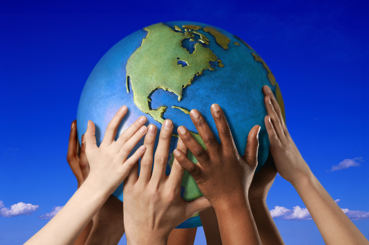 Hands On A Globe Image By © Royalty Free/corbis - Tamarthi